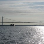Tug passing under the Whitestone Bridge