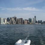 Towing the Dinghy down the East River, Chrysler Bldg towering over