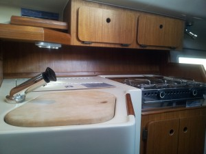 Teak Back Splash and Ice Box light in Galley