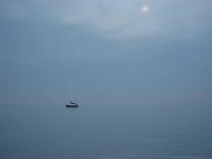 Moon rising over sailboat in the Delaware Bay